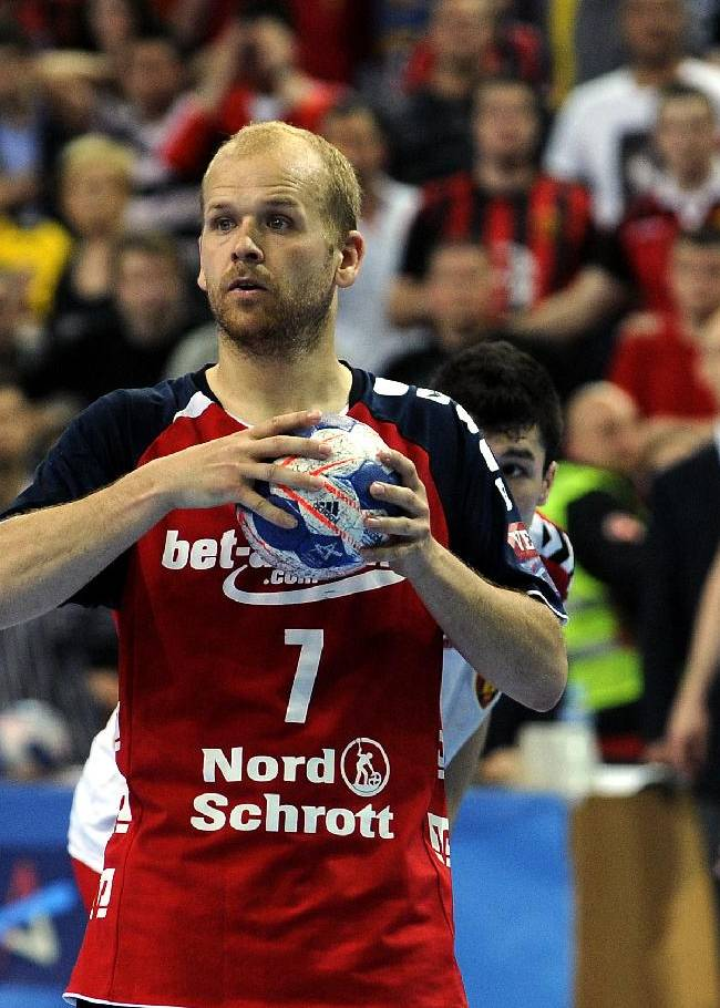Flensburg's Eggert Magnussen waits for the referee's sign before performing a penalty against Vardar in the last moments of the second leg of their quarterfinal handball match of men's EHF Champions League, in Skopje, Macedonia, Saturday April 26, 2014