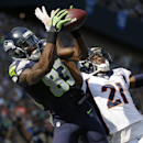 Seattle Seahawks' Ricardo Lockette (83) catches a touchdown pass in the end zone as Denver Broncos' Aqib Talib defends in the first half of an NFL football game Sunday, Sept. 21, 2014, in Seattle The Associated Press