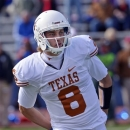 Texas quarterback Case McCoy (6) looks to the sidelines after coming into the game against Kansas Jayhawks the second half of an NCAA college football game in Lawrence, Kan., Saturday, Oct. 27, 2012. (AP Photo/Reed Hoffmann)