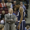 Sacramento Kings head coach Michael Malone jokes with Oklahoma City Thunder forward Kevin Durant during the third quarter of an NBA basketball game in Sacramento, Calif., Tuesday, Dec. 3, 2013. The Thunder won 97-95 The Associated Press