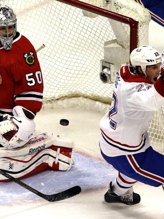 Chicago Blackhawks goalie Corey Crawford (50), left, reacts after Montreal Canadiens' Dale Weise (22) scored a goal during the third period of an NHL hockey game in Chicago, Wednesday, April 9, 2014. The Blackhawks won 3-2 in overtime