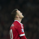 Manchester United's Wayne Rooney reacts after a missed opportunity during the English Premier League soccer match between Manchester United and Southampton at Old Trafford Stadium, Manchester, England, Saturday, Jan. 23, 2016. (AP Photo/Jon Super)