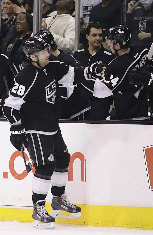 Los Angeles Kings' Jarret Stoll celebrates his goal with teammates during the first period of an NHL hockey game against the Dallas Stars on Monday, Dec. 23, 2013, in Los Angeles