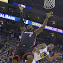 Miami Heat's LeBron James (6) is fouled by Golden State Warriors' Andre Iguodala during the second half of an NBA basketball game Wednesday, Feb. 12, 2014, in Oakland, Calif The Associated Press