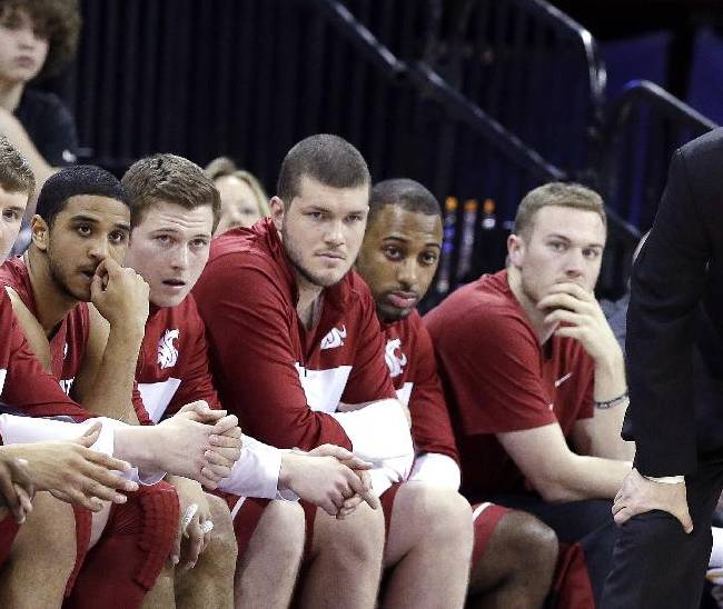 Washington State head coach Ken Bone, right, watches from the end of the team bench late against Washington in the second half of an NCAA college basketball game Friday, Feb. 28, 2014, in Seattle. Washington won 72-49