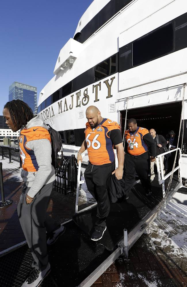 Denver Broncos linebacker Danny Trevathan (59), center Manny Ramirez (66) and defensive tackle Terrance Knighton (94) leave the yacht where their daily news conferences are held Wednesday, Jan. 29, 2014, in Jersey City, N.J. The Broncos are scheduled to play the Seattle Seahawks in the NFL Super Bowl XLVIII football game Sunday, Feb. 2, in East Rutherford, N.J