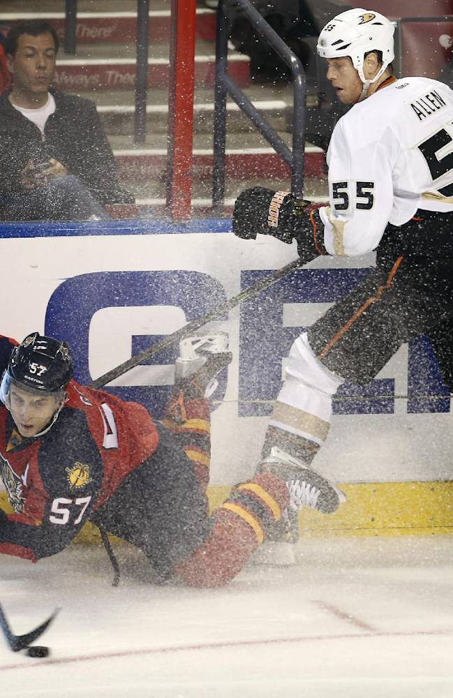 Anaheim Ducks' Bryan Allen (55) watches as Florida Panthers' Marcel Goc (57) goes for the puck during the second period of an NHL hockey game in Sunrise, Fla., Tuesday, Nov. 12, 2013