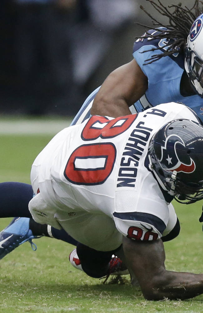 Tennessee Titans' Michael Griffin (33) breaks up a pass intended for Houston Texans' Andre Johnson (80) during the third quarter of an NFL football game on Sunday, Sept. 15, 2013, in Houston