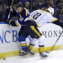 St. Louis Blues' Kevin Shattenkirk, left, and Nashville Predators' Paul Gaustad chase after a loose puck along the boards during the first period of an NHL hockey game Thursday, Jan. 29, 2015, in St. Louis The Associated Press
