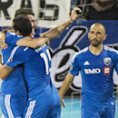 Montreal Impact's Ignacio Piatti, left, celebrates with teammates Dilly Duka (11) and Marco Di Vaio, right, after scoring against the Columbus Crew during first half MLS soccer action in Montreal, Saturday, Aug. 30, 2014 The Associated Press