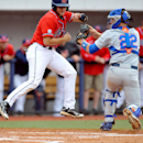 Mississippi's Austin Knight, left, is tagged out by Florida catcher J.J. Schwarz (22) during the NCAA baseball game at Oxford-University Stadium in Oxford, Miss. on Saturday, March 21, 2015. (AP Photo/Oxford Eagle, Bruce Newman)