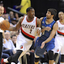 Minnesota Timberwolves' Ricky Rubio (9) defends against Portland Trail Blazers' Wesley Matthews (2) during the first half of an NBA basketball game in Portland, Ore., Sunday, Feb. 23, 2014 The Associated Press