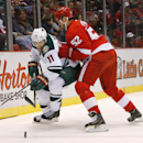 Detroit Red Wings defenseman Jonathan Ericsson (52) defends Minnesota Wild left wing Zach Parise (11) in the first period of an NHL hockey game in Detroit Tuesday, Jan. 20, 2015 The Associated Press