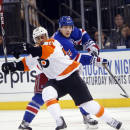 New York Rangers' Jesper Fast, right, of Sweden, battles for possession with Philadelphia Flyers' Pierre-Edouard Bellemare, of France, during the first period of an NHL preseason hockey game Monday, Sept. 29, 2014, in New York. (AP Photo/Jason DeCrow)