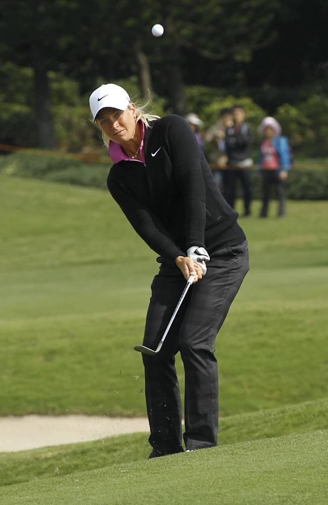 Suzann Pettersen of Norway chips onto the 2nd green during the third day of the LPGA Taiwan Championship tournament at the Sunrise Golf and Country Club, Saturday, Oct. 26, 2013, in Yangmei, northern Taiwan