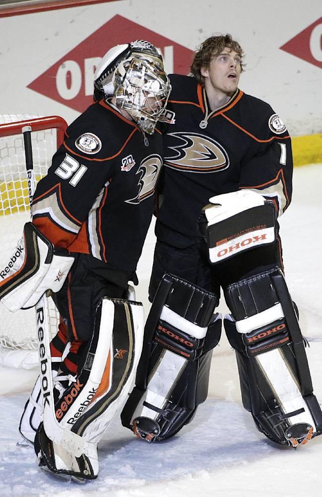 Anaheim Ducks goalies Frederik Andersen, left, of Denmark, and Jonas Hiller, of Switzerland, celebrate their team's 3-2 win against the Dallas Stars in Game 2 of the first-round NHL hockey Stanley Cup playoff series on Friday, April 18, 2014, in Anaheim, Calif