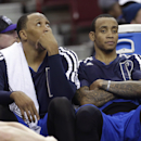 Dallas Mavericks forward Shawn Marion, left, looks up at the scoreboard while sitting on the bench with teammate Monta Ellis in the closing moments of the Mavericks' 112-97 loss to the Sacramento Kings in an NBA basketball game in Sacramento, Calif., Mond