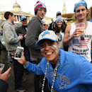 A football fan smiles during the NFL Fan Rally in Trafalgar Square, London, Saturday, Oct. 25, 2014. The Atlanta Falcons will play the Detroit Lions in an NFL football game at London's Wembley Stadium on Sunday Oct. 26. London's National Gallery of art in