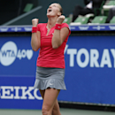 Petra Kvitova of the Czech Republic reacts after winning over Angelique Kerber of Germany at their final match of the Pan Pacific Open Tennis tournament in Tokyo, Saturday, Sept. 28, 2013. (AP Photo/Koji Sasahara)