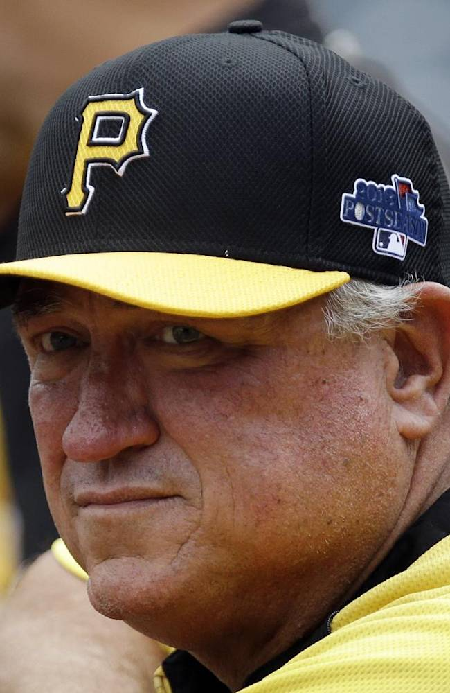 Pittsburgh Pirates manager Clint Hurdle (13) watches batting practice from behind the batting cage during the baseball team's workout in Pittsburgh on Monday, Sept. 30, 2013. The Pirates are scheduled to face the Cincinnati Reds in the National League Wild Card game Tuesday in Pittsburgh