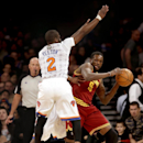 Cleveland Cavaliers' Luol Deng, right, tries to pass around New York Knicks' Raymond Felton, left, and Tim Hardaway Jr. during the first half of an NBA basketball game at Madison Square Garden, Sunday, March 23, 2014, in New York The Associated Press