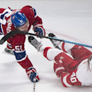Montreal Canadiens' David Desharnais (51) collides with Detroit Red Wings' Henrik Zetterberg during first period NHL hockey action in Montreal, Tuesday, Oct. 21, 2104 The Associated Press