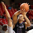 Kansas State's Rodney McGruder shoots under pressure from Texas Tech's Toddrick Gotcher during an NCAA college basketball game in Lubbock, Texas, Tuesday, Feb. 5, 2013. (AP Photo/Lubbock Avalanche-Journal, Zach Long)