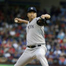 New York Yankees starting pitcher Hiroki Kuroda of Japan throws during the first inning of a baseball game against the Texas Rangers Wednesday, July 30, 2014, in Arlington, Texas. (AP Photo/LM Otero)