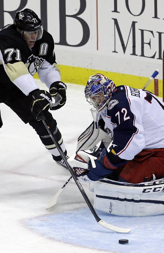 Pittsburgh Penguins' Evgeni Malkin (71) has the puck slip off the end of his stick before he can put it behind Columbus Blue Jackets goalie Sergei Bobrovsky (72) in the first period of an NHL hockey game in Pittsburgh on Friday, Nov. 1, 2013
