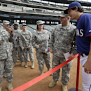 Texas Rangers' Derek Holland, right, poses with U.S. Army soldiers of the 300th Sustainment Brigade of Grand Prairie, Texas, before a baseball game against the Philadelphia Phillies, Monday, March 31, 2014, in Arlington, Texas The Associated Press