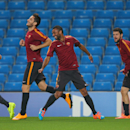 Roma's Ashley Cole, centre reacts with teammates, during a training session, at the Etihad Stadium, in Manchester, England, Monday, Sept. 29, 2014. Roma will be playing Manchester City in a Champions League Group E soccer match on Tuesday
