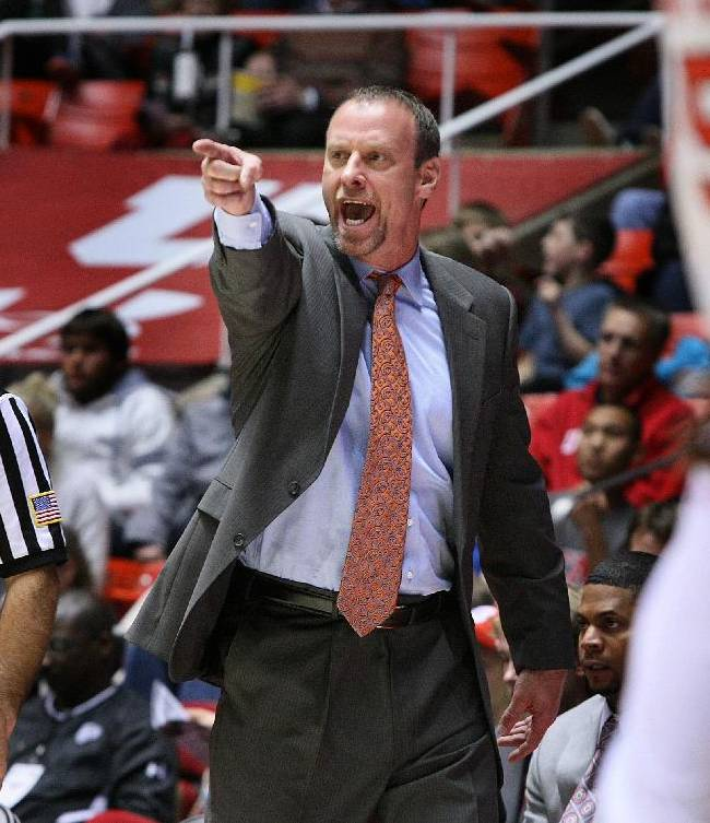 Utah Utes head coach Larry Krystkowiak yells instructions to his team during second half play. Utah defeated UC Davis 94-60, Friday, November 15, 2013 in Salt Lake City, Utah