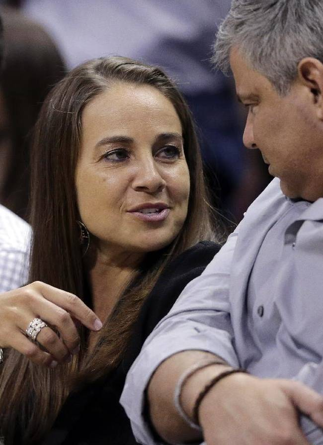 In this April 30, 2014 photo, San Antonio Stars' Becky Hammon attends Game 5 of the opening-round NBA basketball playoff series between the San Antonio Spurs and Dallas Mavericks in San Antonio. Gregg Popovich said that he believes Hammon and other women can cross over and coach men, even in the NBA