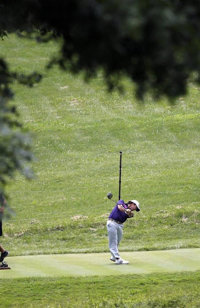 Brian Harman, framed by trees, hits his tee shot on the eight hole during the third round of the 2014 John Deere Classic golf tournament at TPC Deere Run in Silvis, Ill., Saturday, July 12, 2014