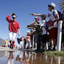 Washington Nationals starting pitcher Stephen Strasburg walks past a puddle after signing autographs following spring training baseball workout, Monday, Feb. 17, 2014, in Viera, Fla The Associated Press