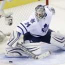Toronto Maple Leafs goalie James Reimer stops a shot by the San Jose Sharks during the second period of an NHL hockey game Thursday, Jan. 15, 2015, in San Jose, Calif The Associated Press