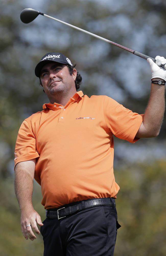 Steven Bowdich, of Australia, watches hits his tee shot on the second hole during the third round of the Texas Open golf tournament, Saturday, March 29, 2014, in San Antonio