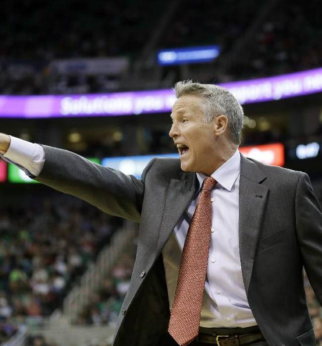 Philadelphia 76ers head coach Brett Brown shouts to his team in the second half of an NBA basketball game against the Utah Jazz, Wednesday, Feb. 12, 2014, in Salt Lake City