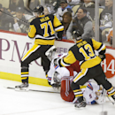 New York Rangers' Dan Girardi (5) hits the ice after being checked by Pittsburgh Penguins' Evgeni Malkin (71) in the third period of an NHL hockey game, Saturday, Nov. 15, 2014, in Pittsburgh. Girardi left the ice after the hit but did return to the game.
