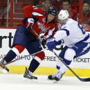 Washington Capitals center Brooks Laich (21) collides with Tampa Bay Lightning defenseman Andrej Sustr (62), from the Czech Republic, as they go for the puck in the first period of an NHL hockey game, Saturday, Dec. 13, 2014, in Washington The Associated