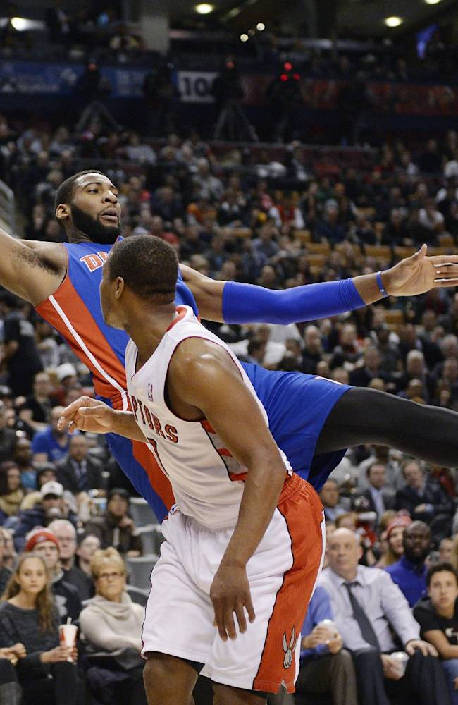 Detroit Pistons centerAndre Drummond, top, lunges backward out of bounds to keep a ball in play as Toronto Raptors guard Kyle Lowry looks on during first-half NBA basketball game action in Toronto, Wednesday, Jan. 8, 2014
