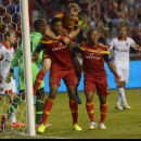 Real Salt Lake defender Chris Schuler (28) reacts to his second goal with defender Nat Borchers (6) and forward Joao Plata (8) during the first half of an MLS soccer game against DC United, Saturday, Aug. 9, 2014, in Sandy, Utah The Associated Press