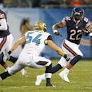 Chicago Bears running back Matt Forte (22) tries to avoid a tackle by Jacksonville Jaguars linebacker Nate Stupar (54) during the first half of an NFL preseason football game in Chicago, Thursday, Aug. 14, 2014 The Associated Press