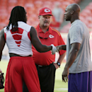 Kansas City Chiefs running back Jamaal Charles, left, shakes hands with Minnesota Vikings running back Adrian Peterson, right, as former Vikings coach and current Chiefs spread game coach Brad Shildress, center, looks on before an NFL preseason football g