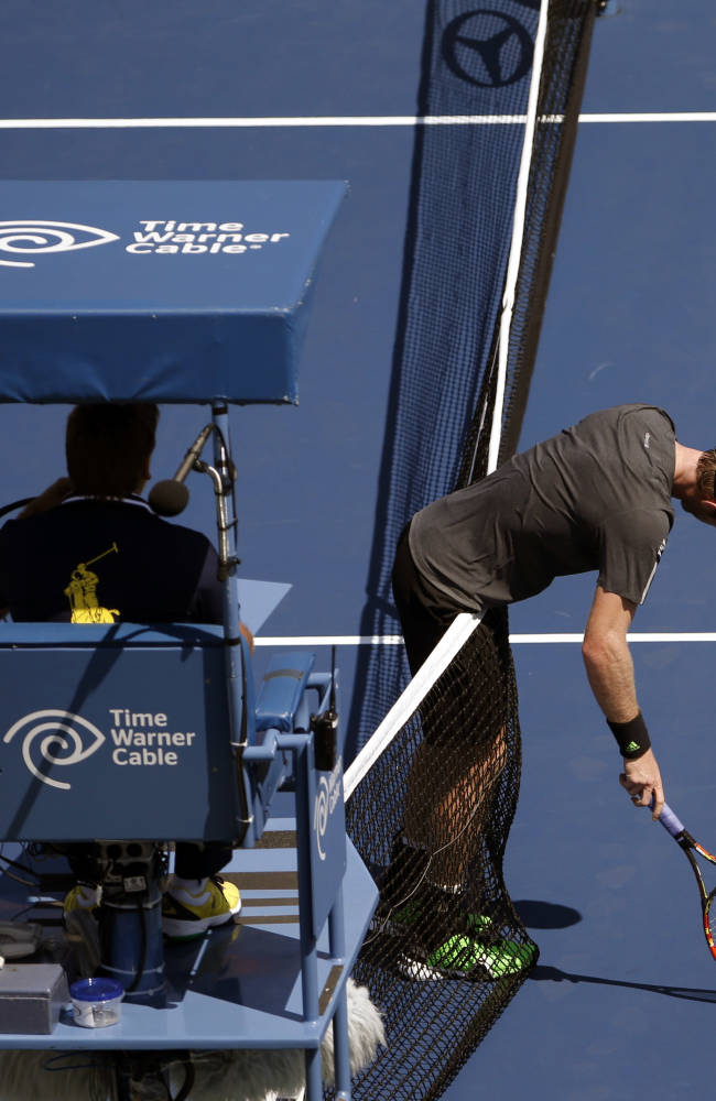 Andy Murray, of the United Kingdom, leans over the net after a shot against Robin Haase, of the Netherlands, during the opening round of the 2014 U.S. Open tennis tournament, Monday, Aug. 25, 2014, in New York