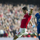 Arsenal's Mikel Arteta shoots to score against Everton, during their FA Cup quarterfinal soccer match, at Emirates Stadium, in London, Saturday, March 8, 2014