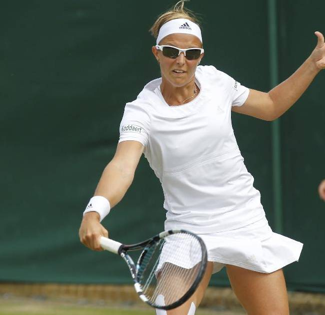 Kirsten Flipkens of Belgium plays a return to Lourdes Dominguez Lino of Spain during their match at the All England Lawn Tennis Championships in Wimbledon, London, Thursday, June 26, 2014