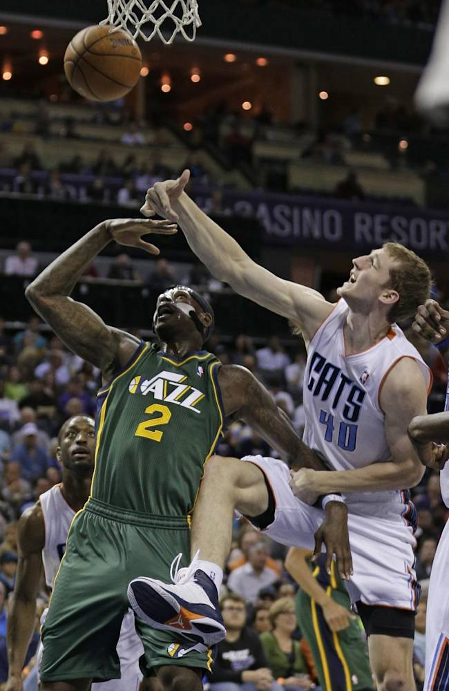 Utah Jazz's Marvin Williams (2) is fouled by Charlotte Bobcats' Cody Zeller (40) during the first half of an NBA basketball game in Charlotte, N.C., Saturday, Dec. 21, 2013