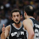 San Antonio Spurs guard Marco Belinelli, left, of Italy, is congratulated by guard Manu Ginobili, of Argentina, after hitting his fourth 3-point basket against the Denver Nuggets in the first quarter of an NBA basketball game in Denver, Friday, March 28,