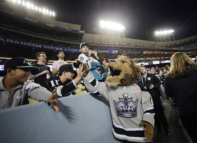 The Los Angeles Kings mascot, Bailey, high fives the fans before an NHL outdoor hockey game against the Anaheim Ducks at Dodger Stadium on Saturday, Jan. 25, 2014, in Los Angeles